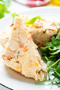 Chicken casserole with vegetables served green salad selective focus closeup Stock Photography