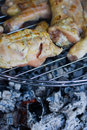Chicken chops on grill Stock Photos