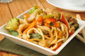 Chicken chow mein a bowl of with a cup of tea Royalty Free Stock Image