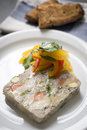 Chicken confit terrine with roasted garlic fennel and pickled sweet peppers Royalty Free Stock Photography