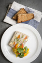 Chicken confit terrine with roasted garlic fennel and pickled sweet peppers toast to side Stock Image