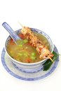 Chicken consomme a bowl of and a skewer Royalty Free Stock Photography