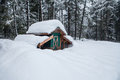 Chicken coop in deep snow outbuilding buried an alaskan winter Stock Images