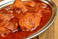 Chicken curry indian dish of in red Royalty Free Stock Photo