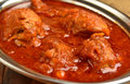 Chicken curry indian dish of in red Royalty Free Stock Images