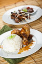 Chicken curry and pork satay Stock Image