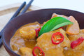 Chicken curry on a wooden bowl red thai Royalty Free Stock Images