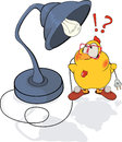 Chicken and a desk lamp cartoon Royalty Free Stock Photo