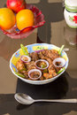 Chicken dish fried served on the table with oranges and other fruits spoons in a diner or restaurant table in a bowl an indian Stock Photo