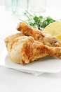 Chicken drumsticks roast or legs against a light bright background with copy space availability lemon garnish with parsley herbs Stock Photos