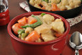 Chicken and dumplings with carrots and green beans a bowl of Stock Images