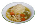 Chicken and dumplings in a white bowl with green rim