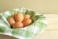Chicken egg and relate mat on basket raw Stock Photo