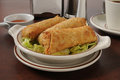 Chicken egg rolls a plate of with sweet and sour sauce Royalty Free Stock Photo