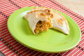 Chicken empanada argentinean pie on green plate Royalty Free Stock Photography