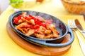 Chicken fajita smoking hot served on iron plate Royalty Free Stock Photo