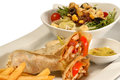 Chicken fajita wrap sandwich with sauce and salad Stock Photography