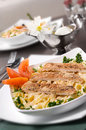 Chicken fettuccine alfredo chicken fettuccine alfredo chicken fe classic creamy topped with slices of grilled breast Stock Image