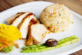 Chicken fillet with fried rice on white plate Stock Image