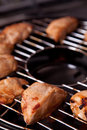 Chicken fillet on gas grill tasty Stock Image