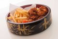 Chicken and french fries on a beautiful chinese dish Stock Images