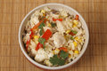 Chicken fried rice in a bowl from above containing capsicum garlic egg Stock Photo