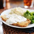Chicken fried steak and gravy with southern style peppered milk Stock Photos