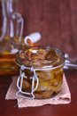 Chicken gizzards confit in olive oil a glass jar Royalty Free Stock Photos