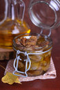 Chicken gizzards confit in olive oil a glass jar Royalty Free Stock Images