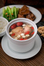 Chicken and herb soup in pot asia food Stock Photos