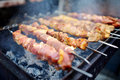 Chicken kabobs grilled on metal skewers Royalty Free Stock Photo