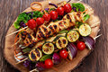 Chicken kebab with vegetables grilled on bbq roast filet cherry tomatoes zucchini and red onions bamboo sticks Stock Image