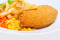 Chicken Kiev with corn and french fries Royalty Free Stock Photo