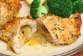 Chicken kiev dinner with broccoli and roast potatoes Stock Image