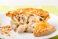 Chicken and leek pie cut open on plate Royalty Free Stock Photos