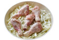 Chicken leg with cabbage raw legs and in a pan Stock Photo