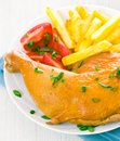 Chicken leg with potato and tomato Royalty Free Stock Images