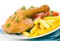 Chicken leg with potato and tomato Royalty Free Stock Photos