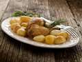 Chicken leg with potatoes Royalty Free Stock Images
