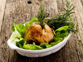 Chicken leg with  salad Royalty Free Stock Photography