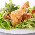 Chicken leg and salad grilled Stock Photos