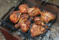 Chicken legs on the grill for barbecue Royalty Free Stock Photos