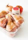 Chicken legs and spices Royalty Free Stock Photography