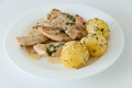 Chicken meal cooked in white creamy sauce with boiled potatoes Royalty Free Stock Photography