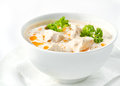 Chicken and mushrooms cream soup on white surface Royalty Free Stock Images