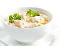 Chicken and mushrooms cream soup on white surface Stock Image