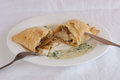 Chicken with mushrooms in puff pastry with cream sauce basil and spinach on white plate Royalty Free Stock Photos