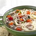 Chicken noodle soup with crackers Royalty Free Stock Photography
