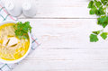 Chicken noodle soup on a white wooden table frame Royalty Free Stock Photos