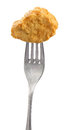 Chicken nugget on fork against white background Royalty Free Stock Photography